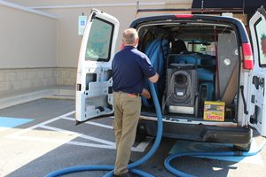 Disaster Restoration Van And Technician At Commercial Job Location