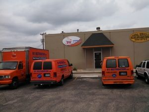 Water Damage Restoration Fleet At Office Job