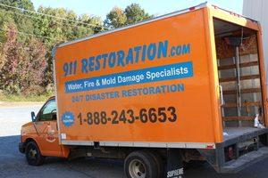 Fire Damage Restoration Truck At Job Site